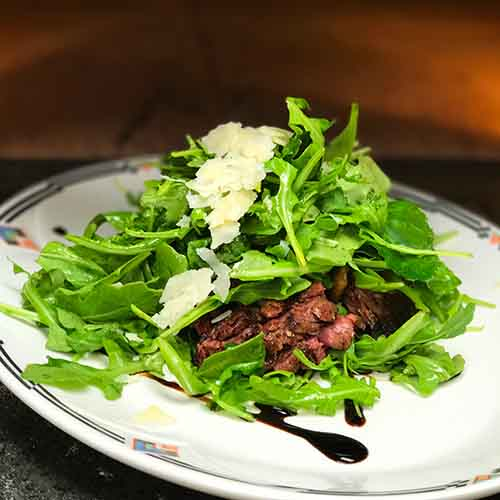 Skirt steak over salad
